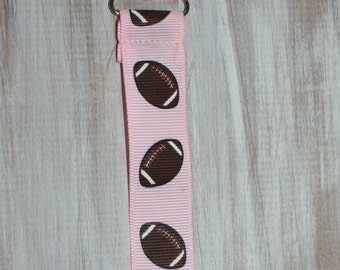 Baby girl pink and brown football ribbon suspender binky clip