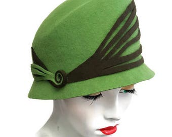 Grass Green cloche style hat with high shaped crown narrow brim and bottle green trim vintage style