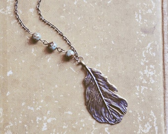 feathered nest necklace.