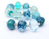 Handmade lampwork glass bead set of 12 mainly turquoise coloured renegade beads - lampwork orphan beads