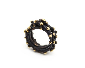 Oxidized black and gold