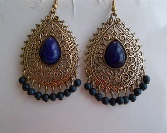 Gold Tone Teardrop Earrings with Blue Ball Dangles and a Blue Center Bead