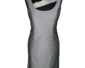 Gray shift  bodycon  dress with an addition at the bottom and neckline .Versatile grey dress, very smart for day wear / work,