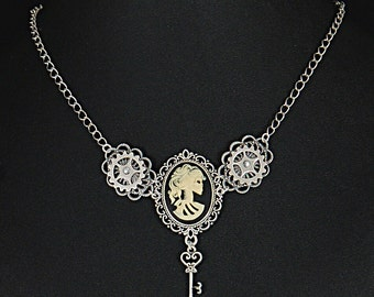 Antique silver Steampunk Lolita zombie lady cameo set in filigree with moving riveted gears.