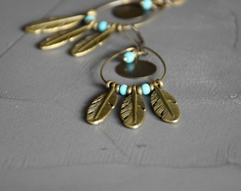Feather earrings Miwok ring and bronze medal