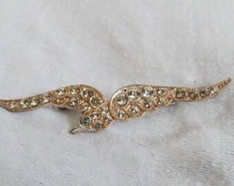 A vintage diamante bird brooch