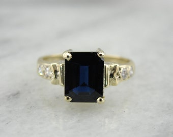 Navy Blue Sapphire Anniversary Ring in Rich Yellow Gold R3MVWH-P