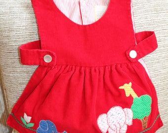 """Vintage Baby red side-button pinafore. Red corduroy.  Animal & tulip pattern. Classic Child. Unique. 3-6 mo 11.5"""" length (down back)"""