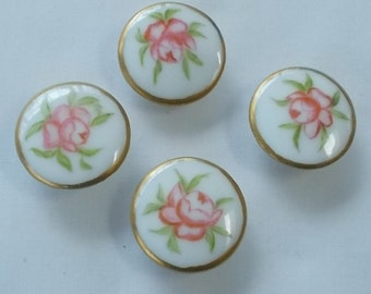 456.  Set of Four Handpainted Porcelain Floral Stud Buttons