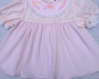 Pink Vintage toddler dress with pleated skirt and polka dots. Approx size 2.