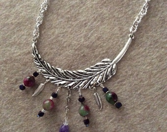 Metal pendant with various wire wrapped dangles