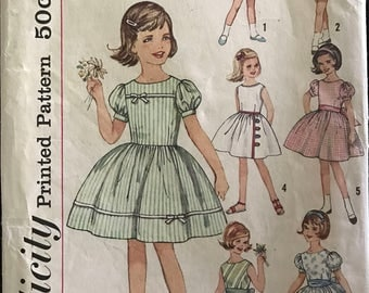 Simplicity 4369 - 1960s Girl's Sleevess or Short Puff Sleeved Dress with Flared Skirt - Size 8