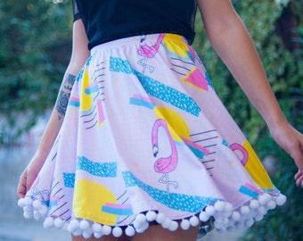 Flamingo sunrise skater skirt in pastel colors with extra large white pom poms | retro style pattern print skirt