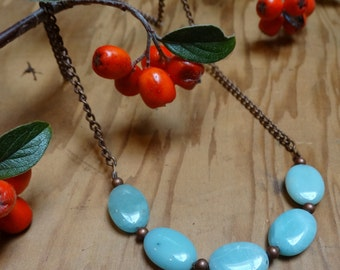 "Oval amazonite stones, round copper spacer beads on an 18"" copper chain."