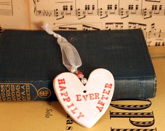 Happily Ever After Handmade Pottery Heart, with white & red glazes. Sent to you in a lovely gossamer bag ready to be given as a gift.