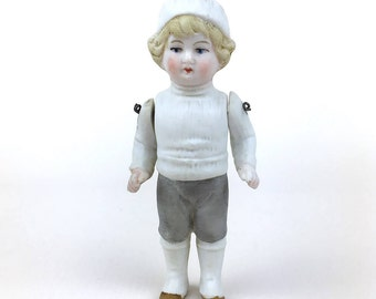 Antique all bisque miniature doll, boy doll, molded costume, all bisque boy