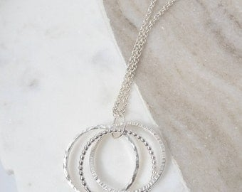 Entwined three ring necklace. Sterling silver trilogy entwined necklace. Circle necklace. Trilogy necklace. Linked circle necklace.
