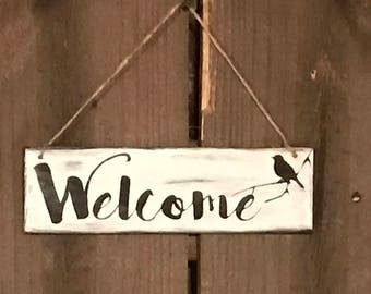 Welcome wood sign with rope hanger