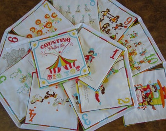 Hand quilted bunting for counting. Circus themed fabric number bunting. Colourful circus themed bunting for child's bedroom. Made in the UK.