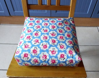 Toddler booster cushion,zipped, refillable with ties 9cm deep. Wipeable laminated Cath Kidston Rose fabric.