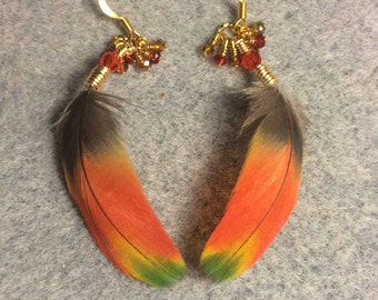 Bright orange red, yellow and green scarlet macaw feather earrings adorned with tiny dangling orange, red, and amber Chinese crystal beads.