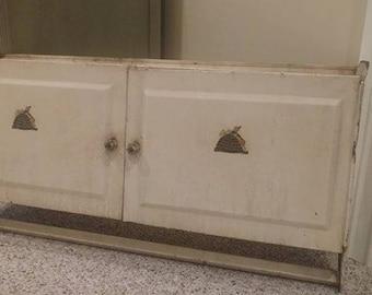 Vintage metal cabinet with towel holder