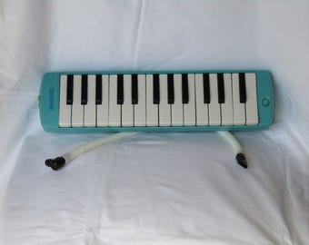 Vintage Angel melodica Musical Instrument. Vintage melodica, Melodica, Angel melodica, vintage decor, light blue melodica.