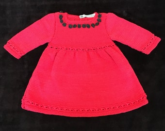 Handmade hand-knitted baby girls red jumper dress black satin buttons at the back and satin rose decor age 18-24 months see details