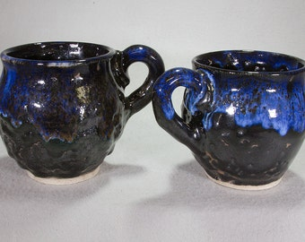 Pair of Unusual Large Black Volcanic Mugs with Bright Blue Overglaze