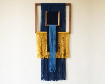 macrame wall hanging with wooden picture frames | geometric tapestry | blue and yellow yarn | colorful interior | textile art | boho home