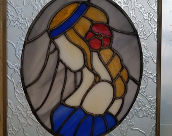 Girl in blue stained glass window hanging