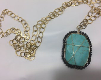 Turquoise and Black Crystal Wrapped Pendent with Gold Chain