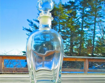 Glass  Wine Decanter Made in Italy  Weighs 2  pounds 7 Ounces Measures  9 1/2 inches Tall with Stopper Excellent Condition