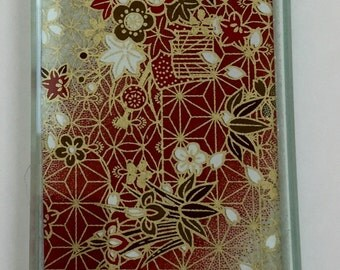 Asian print glass paperweight