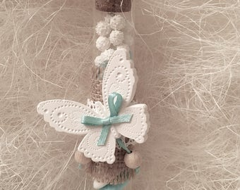 glass vial with butterfly