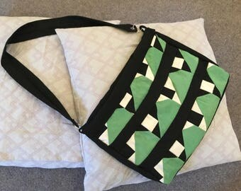 Green and white patchwork messenger bag