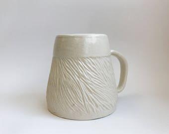 Wheel thrown white textured ceramic mug
