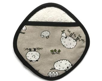 Pocketed pot holder in decorative sheep fabric