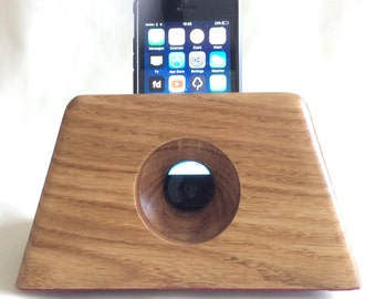 Oak iPhone docking and charging station with acoustic amplifier.