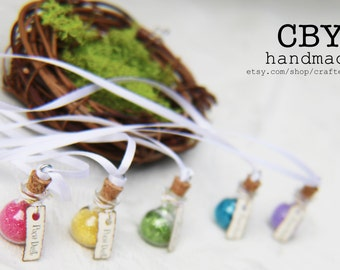 Pixie Dust Vial necklaces with bird's nest display // fairy party favors // Fairy party supplies