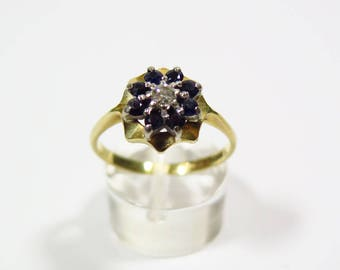 Gold Ring with Saphires and Diamond
