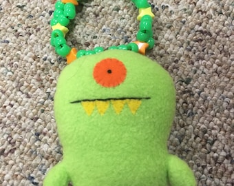 Ugly Doll on a Kandi Cuff bracelet