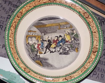 Almost antique (c.1920s) Adams Cries of London vegetable | pasta bowl featuring the Tour of Dr. Syntax with a green, brown rim.