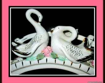 Porcelain swan figurine with gold leaf