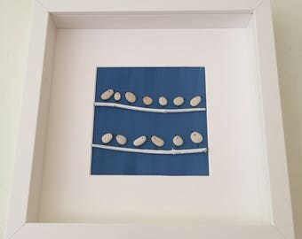 Handmade beach pebble art picture of a family of birds perching on branches. Box frame. Unique gift.