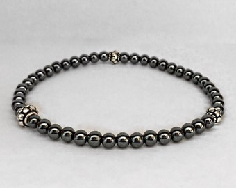 Men's hematite bracelet with bali sterling silver.