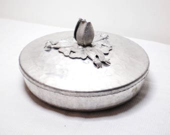 """Vintage Hand Wrought Hammered Aluminum covered dish. Aluminum dish is 7"""" wide by 1.5"""" deep. Marked Hand Wrought Creations, Rodney Kent # 401"""