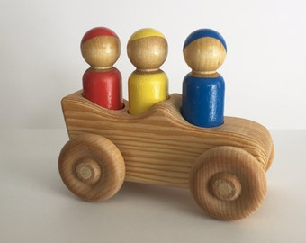 Primary Color Peg Dolls in Wooden Car
