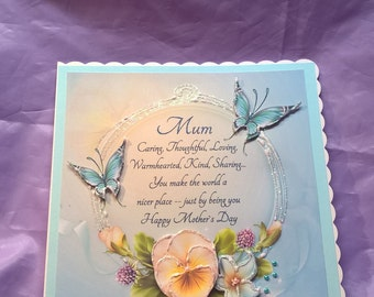 mother's day card in shades of blue and peach with pearls,glitter, butterflies and a lovely verse.
