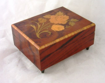 Vintage wooden cigarets box with music box. Beautiful inlay Italian wood work